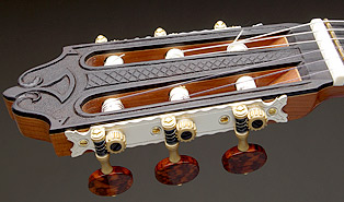 Espressivo - carved headstock